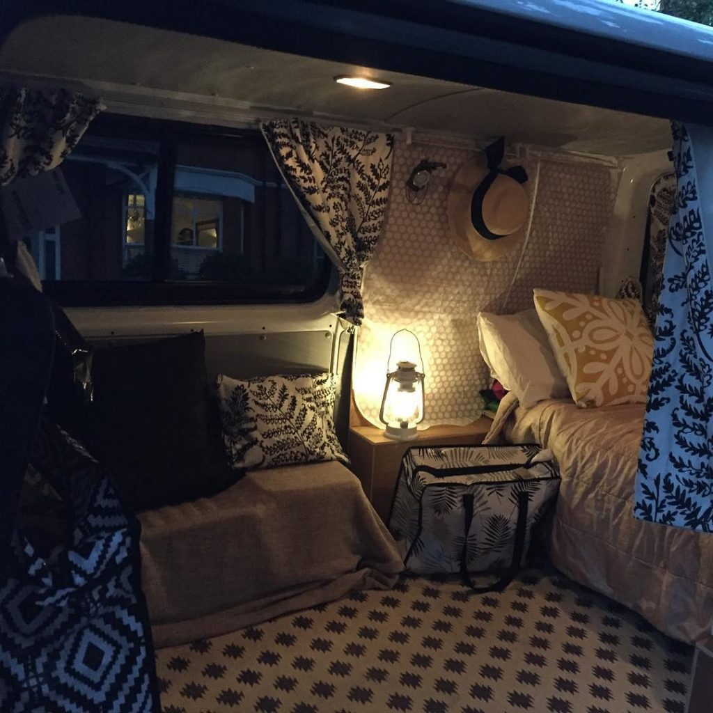 Interior cosy cambee campervan with low lighting