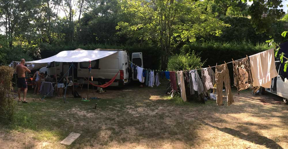 Matthew's camping setup in France showing van parked, awning and washing on the line